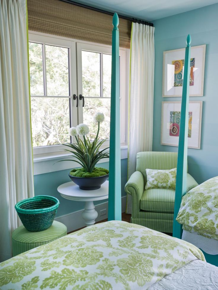 Windows overlook the back deck and verdant green marshland, the inspiration for the room's lime-green bedding and upholstery fabrics.