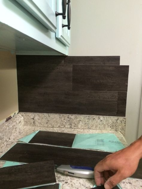 This $40 Vinyl Peel N Stick Flooring Backsplash is thrifty and gorgeous!