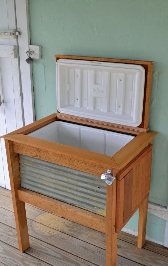 patio cooler stand. How cool would it be to have fold out tables on the side!: