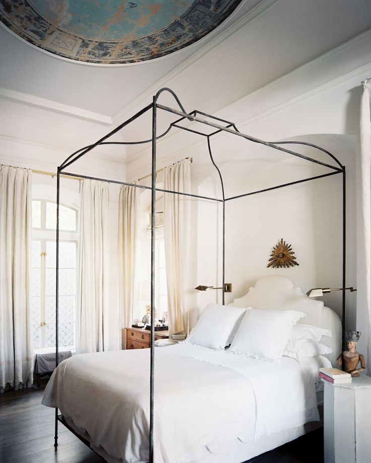Canopy bed, neutral colors, painted ceiling | Lonny Magazine
