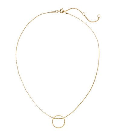 Gold-colored. Narrow chain necklace in metal with a round metal pendant. Adjustable length, 15 3/4 - 18 in.
