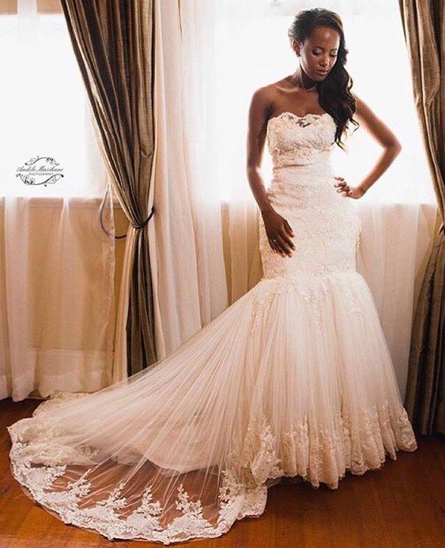 White wedding dress by Zodwa bridal