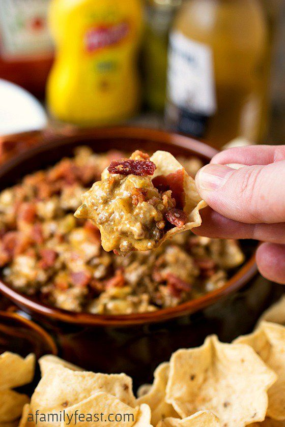 Bacon Cheeseburger Dip - Simple to make and addictively good! Melted cheese, ground beef and all of your favorite toppings in an incredible dip!