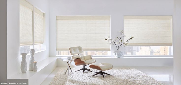 A living room with vase accents. Shown with Provenance Woven Wood Shades, available at Superior Blinds in Litchfield Park, AZ