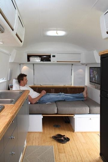 #airstream. so i love the mac that can be used as a tv or as a computer. this couch/bed folds up to become a table and seating.