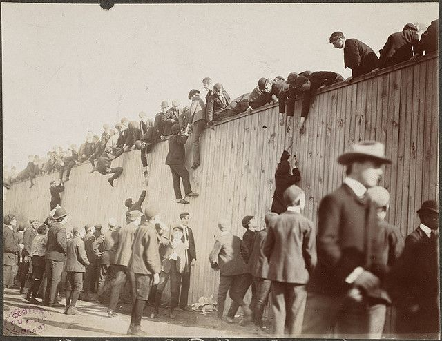 Fans scaling the wall at the Huntington Avenue Grounds, 1903 World Series by Boston Public Library, via Flickr