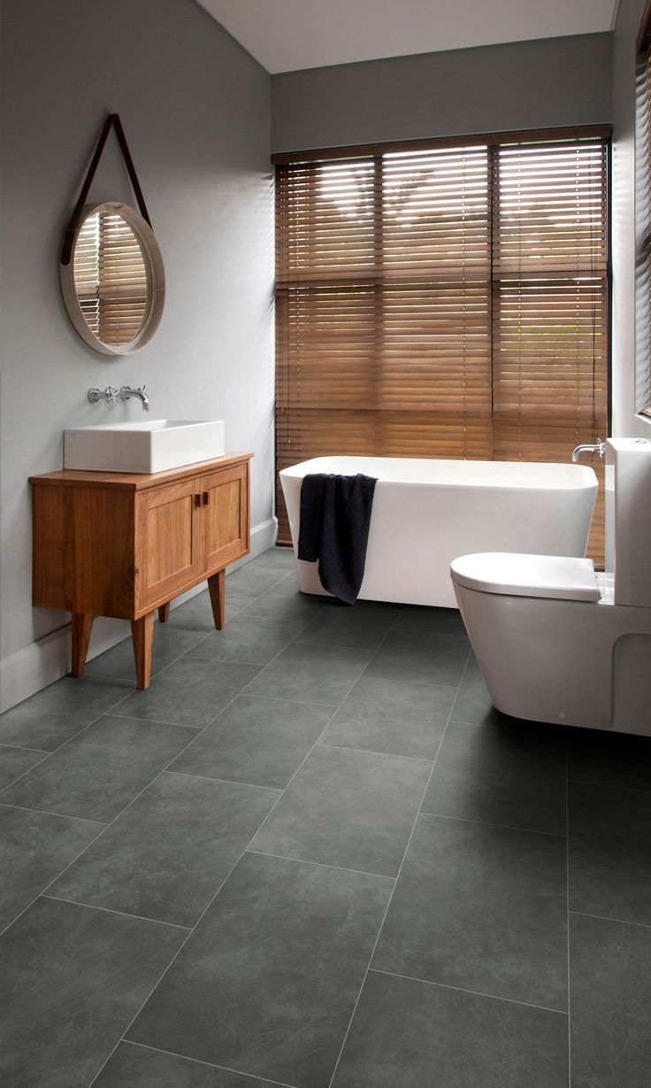 Bathroom featuring Secura PUR luxury vinyl sheet flooring