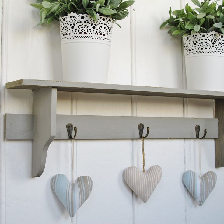 grey rustic wooden wall shelf with 3 coat hooks from