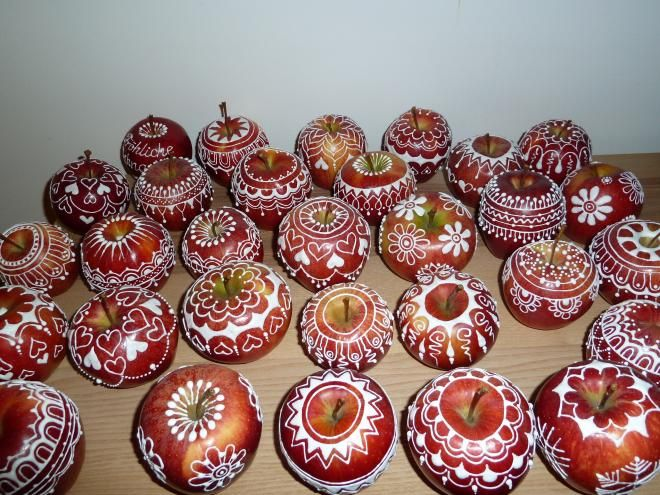 Decorate apples with egg white icing.  Website is in Slovak and Google Translate is not great, but the pictures tell the story.  Beautiful.