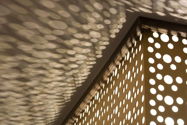 Backlit Perforated Panels Creates Light Pattern On The