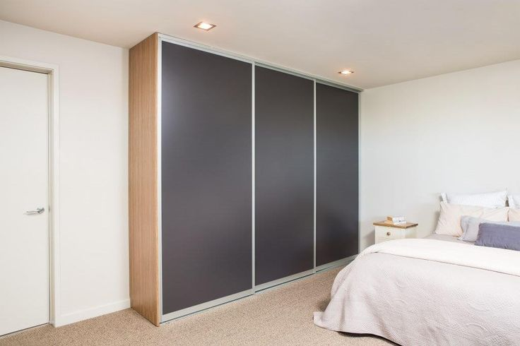 Triple Whisper Sliding doors for a built in wardrobe // Innovative Interiors