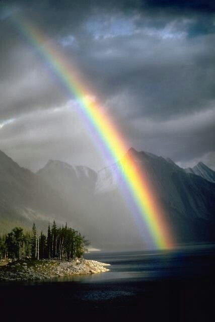 """Rainbow in the Canadian Rockies. """"Rainbows apologize for angry skies"""" (Sylvia Voirols)"""