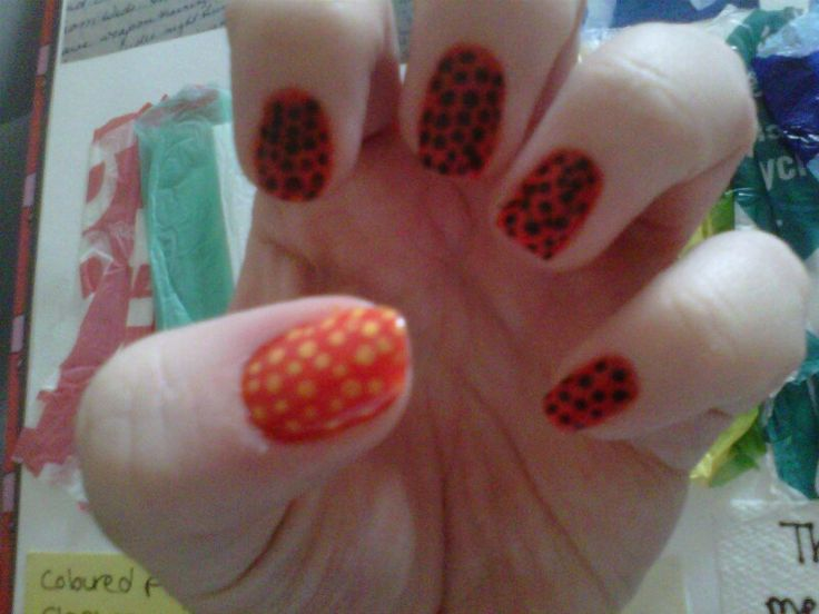 yellow, orange,  black and red dotted nails