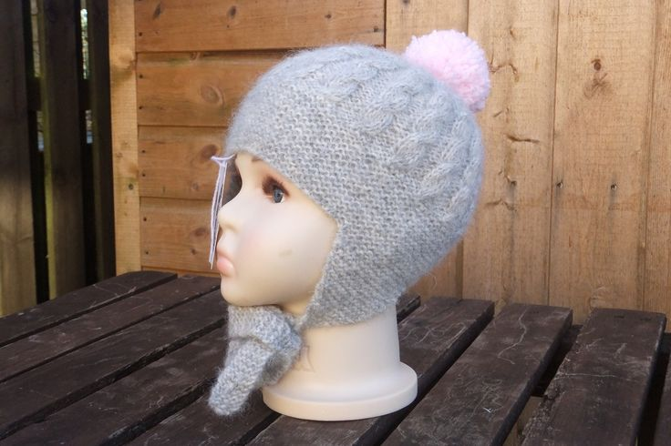 I'm so in love with this hat - sometimes my designs just work first time! This is knitted in an absolutely beautiful yarn - royal baby alpaca, merino wool and acrylic mix. The pompom is an acrylic baby yarn. Machine washable at 30 degree delicate cycle. To fit approx. 1 year £8 +£3 P&P