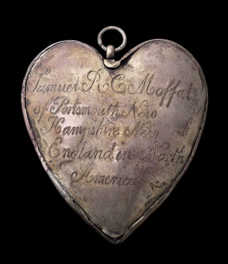 "This amulet charm consists of two heart-shaped plaques, both slightly convex, joined with a narrow strip of silver. The engraved, cursive inscription on the back reads: ""Samuel R C Moffat / of Portsmouth New / Hampshire New / England in North / America."" Engraved on the front is a cartouche with a shield-shaped heraldic device with several bird images. Charms of this type were made to enclose the caul of the owner and were considered protection against drowning."