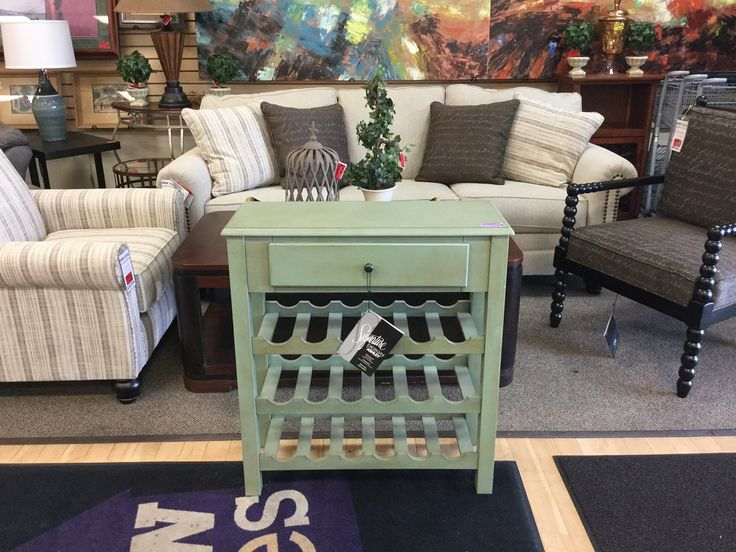 SAVE 70% OFF ALL PURPLE PRICE TAG MERCHANDISE AT NEW USES: Brand New Wine Table from Ashley Furniture originally $189 is now only $56.70!