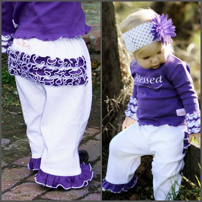 Grape & White Ruffled Crawlers. These picture perfect ruffle pants are just perfect for your little sweetheart! These white pants with vibrant grape ruffles across her bottom and pant hem are stretchy enough for everyday wear for your little lady from newborn to toddler. A 'must have' for your little blessing.