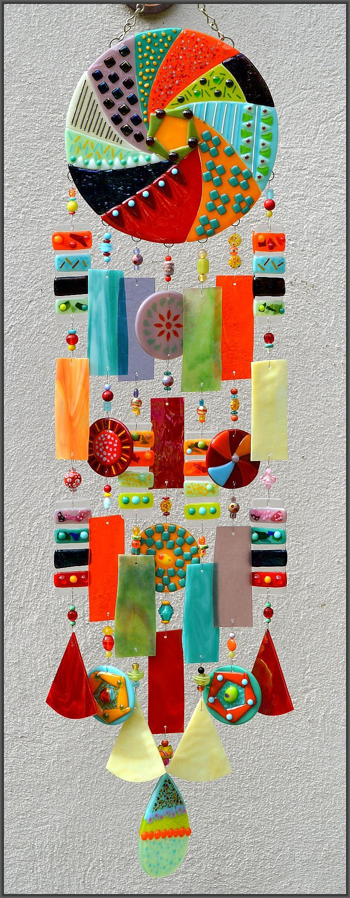 Love all of these...Kirk's Glass Art fused and stained glass windchimes