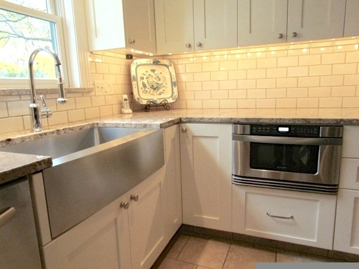 Kitchen Renovation Featuring Farmhouse Style Stainless Steel Sink And Under Counter Microwave Drawer Hidden