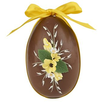 """This classic Easter egg is made by our own chocolatiers, who use expertly tempered milk chocolate to ensure a flawless shine. The decorations are made and applied by hand, meaning that every egg is unique and different, and the egg is filled with a selection of handmade chocolate shapes. It is a work of art in chocolate. Fortnum & Mason, London""."