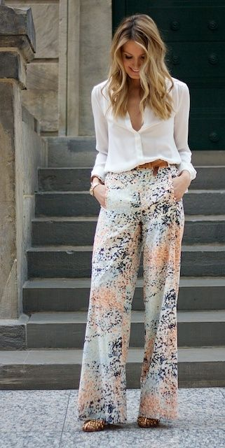 Light flared trousers with a pastel palette for the print, matched with a silk long sleeved white blouse.