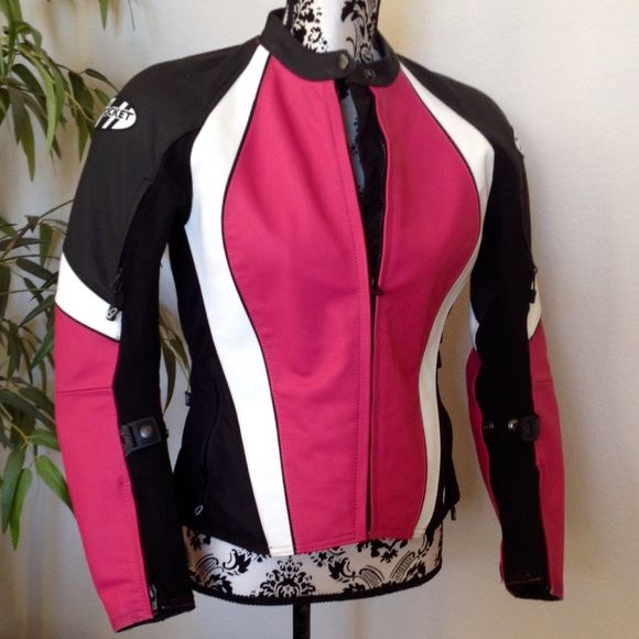 Women's Joe Rocket Aura leather motorcycle jacket Joe Rocket Aura leather motorcycle jacket in Streamlined pink black & white cowhide. Snap missing on one sleeve adjuster otherwise Excellent condition1mm to 1.2mm Leather outer shellAdjustable waistband & rear straps Elastic sleeve adjustersC.E. Approved armor in shoulders & elbowsRemovable spine pad w/pocket for optional C.E. Approved spine pad Variable flow ventilation systemSnap loops for attaching jacket to belt360 zipper for pant…