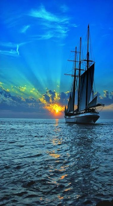 A ship sailing into the sunrise. Check out the Matthew Williamson beach collection at matthewwilliamson.com