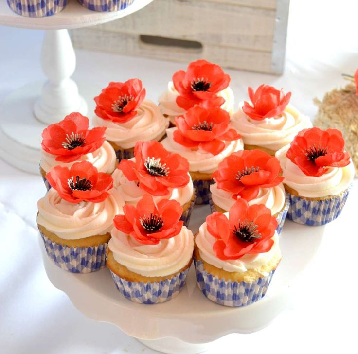 What beautiful cupcakes topped with poppies at this wonderful Wizard of Oz Baby Shower! See more party ideas and share yours at CatchMyParty.com
