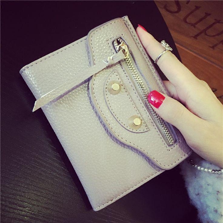 $14.99 (Buy here: https://alitems.com/g/1e8d114494ebda23ff8b16525dc3e8/?i=5&ulp=https%3A%2F%2Fwww.aliexpress.com%2Fitem%2F2016-New-Genuine-leather-women-s-short-design-wallet-fashion-classic-thin-purse-female-Wallets-Cowhide%2F32660187085.html ) 2016 New Split Leather women's short design wallet fashion classic thin purse female Wallets Cowhide for just $14.99