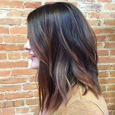 Brunette Eclipting color technique with ribbons of warm caramel and chocolate from Jaclyn Nicole Salon.