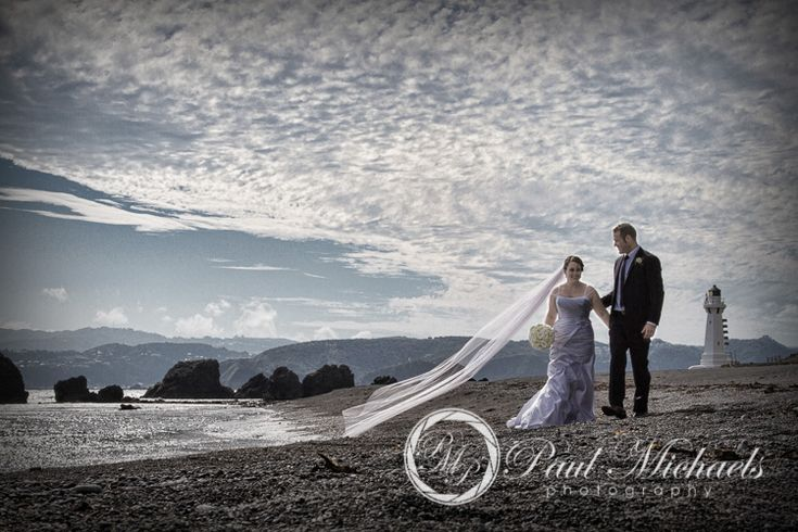 Bride and groom on the beach at Pencarrow lodge.