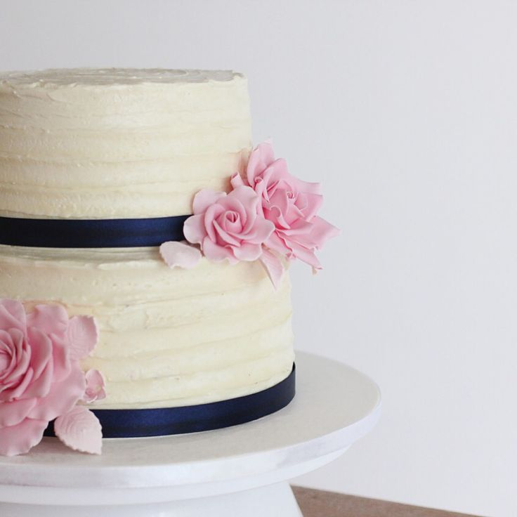 Buttercream and rose two tier wedding cake.