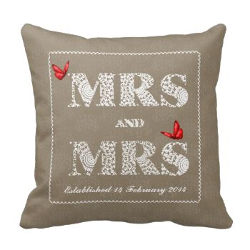 "A special wedding gift on a special day for the happy lesbian couple this white lace effect word art design ""MRS and MRS"" with red butterflies on a neutral tone of taupe brown damask patterned pillow. Don't forget to personalize it with the date of the wedding for that extra special touch to make it a keepsake of the date they established their marriage."