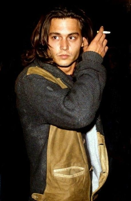 Johnny Depp. I hate to post pics of celebs that smoke.... but some rules just have to be broken. lol