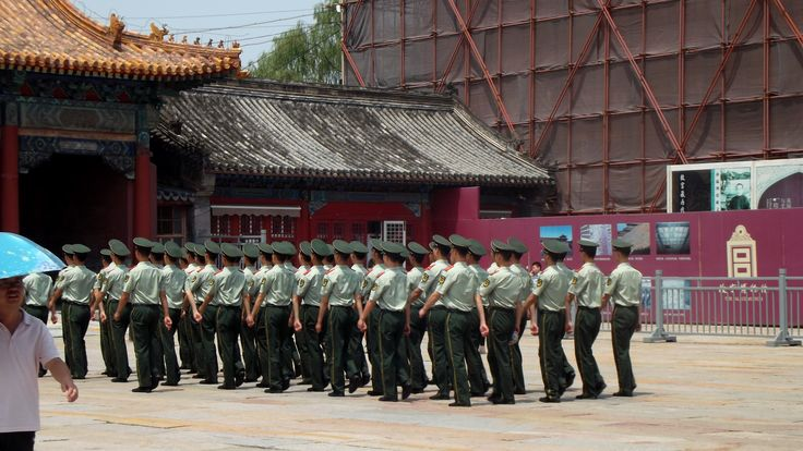 Chinese soldiers marching in formation outside the Forbidden City in #Beijing. June 2014