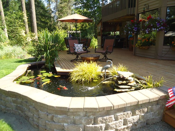 small above ground backyard pond ideas with wooden deck