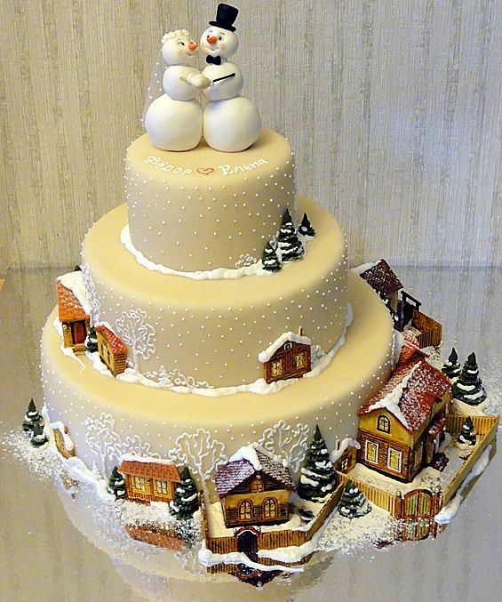 Snow Wedding by Art Cake. The 3D detail on this is amazing! Especially the town on the bottom tier...