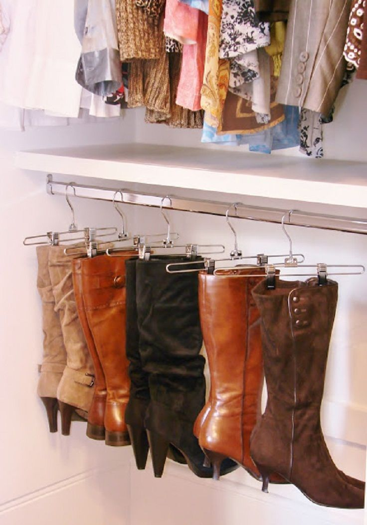 Using pants hangers to hang boots. I just started doing this. It works.