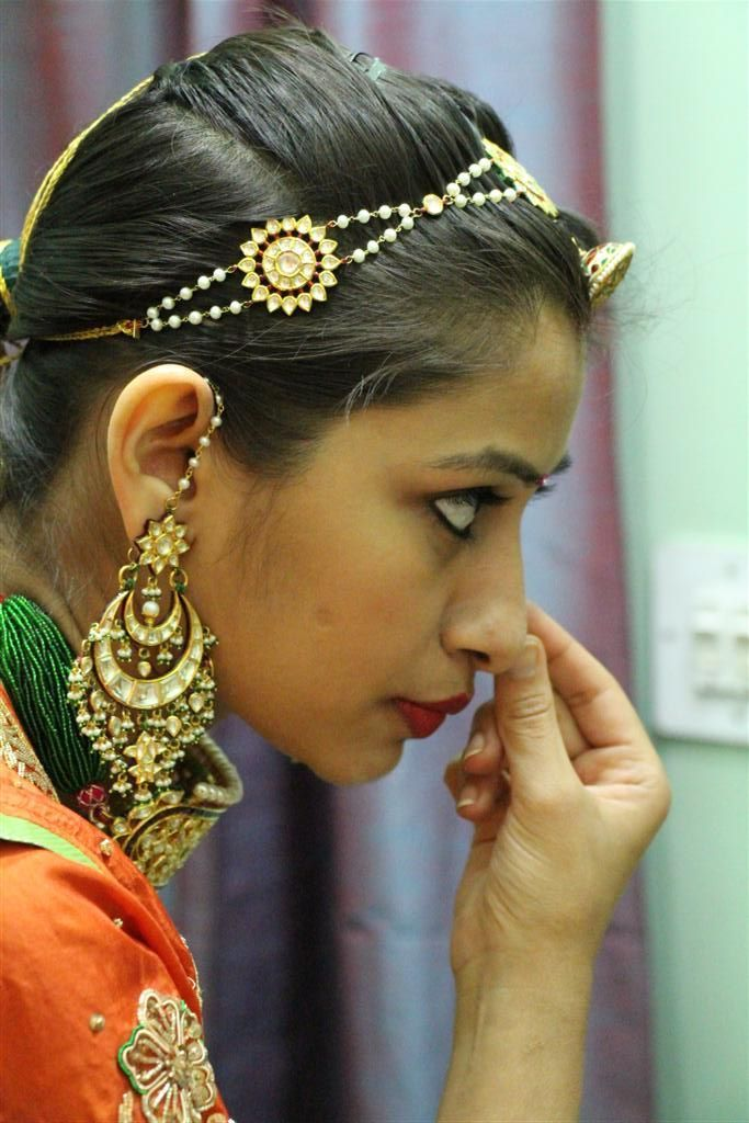A closer look at sheeshphool or studded headband worn with the rakhdi