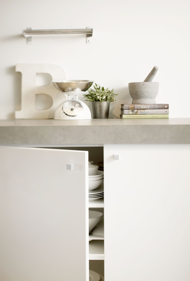 Formica Vinyl doors (Bevelled Edge profile) Warm White, Benchtops in Formica Cast Concrete. Styling Suki Ibbetson. Photography Chris Daile.