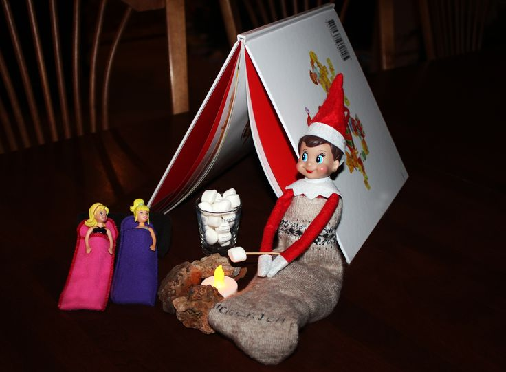 Camping out and roasting marshmallows with the Polly Pockets. Used the Elf book for a tent. #elfontheshelf