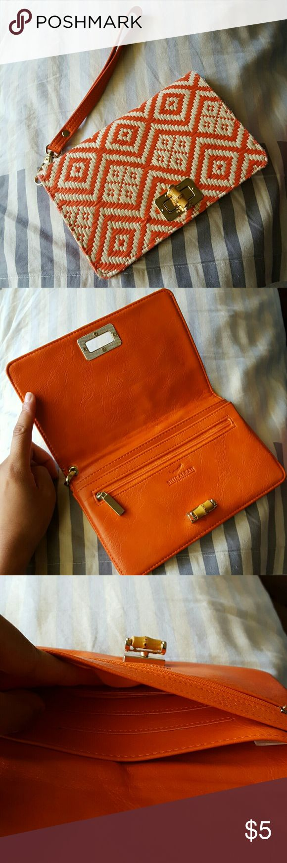 Orange Clutch from Ann Taylor Orange straw wristlet from Ann Taylor - slight flaws when purchased, see last 3 pictures. Otherwise they are unnoticeable. Has slots for credit cards and can fit a phone. Ann Taylor Bags Clutches & Wristlets