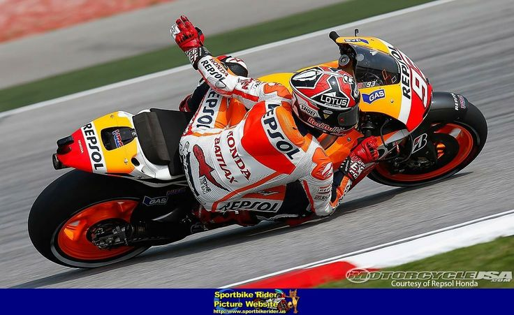 Marc Márquez waving to the crowd while dragging an elbow on his 2013 Honda RC213V | Moto GP ...