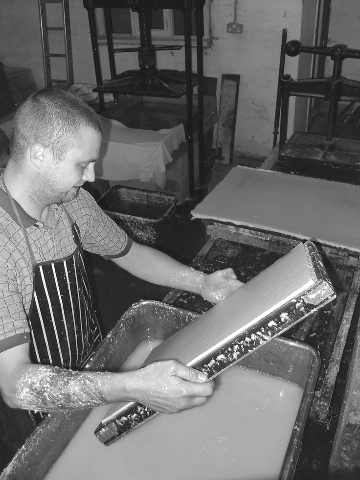 Gary Fuller from Two Rivers Paper Company draining water from a handmade sheet of paper. Picture taken at Frogmore Paper Mill, Hemel Hempstead.