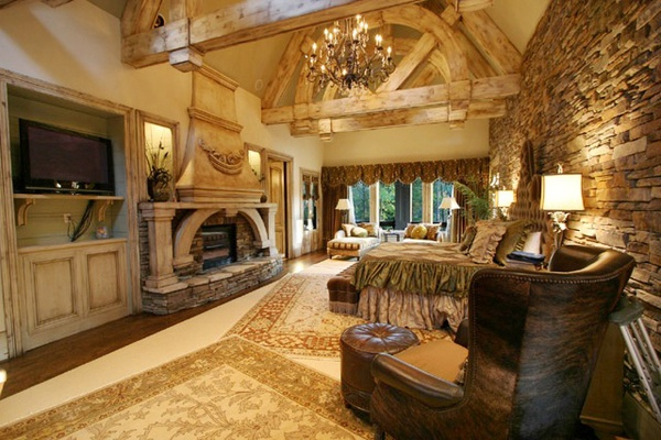 Now, THIS is a master bedroom!  Absolutely love the rock wall and the fireplace... don't need 9,000 SF though...  Corrineaux Estate House Plan: 2 story, 8920 square foot, 5 bedroom, 5 full bathrooms