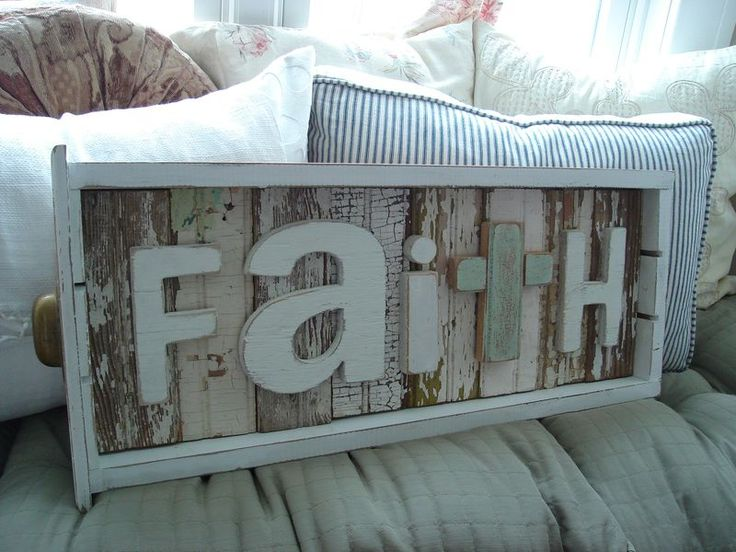 Faith.  Looks like a shallow drawer with maybe barn boards and letters.
