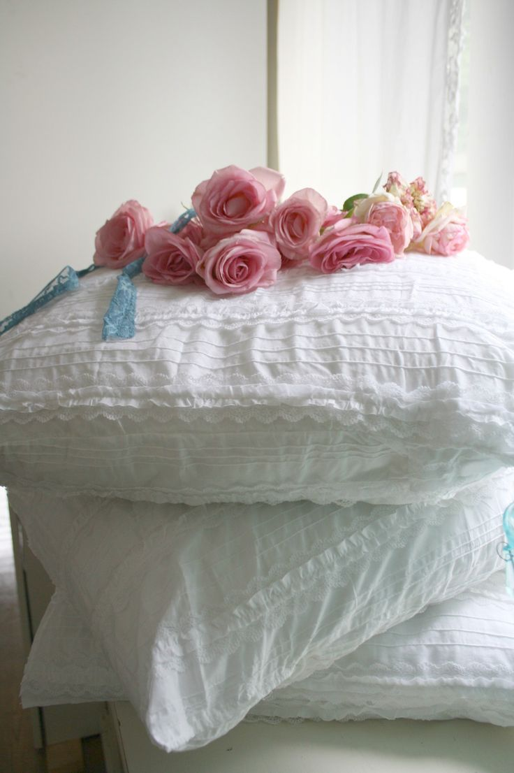 Shabby Chic, love the white fabric on the pillows...seersucker maybe?
