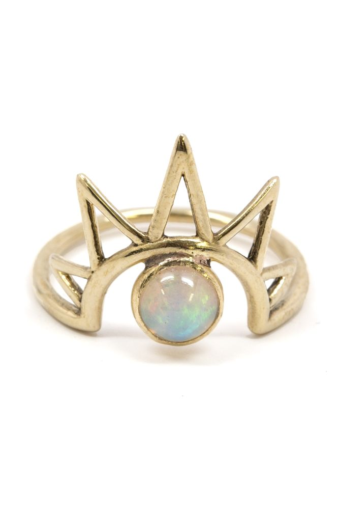 This handmade ring features Avrocomy's signature sunny inspiration and a beautiful opal.