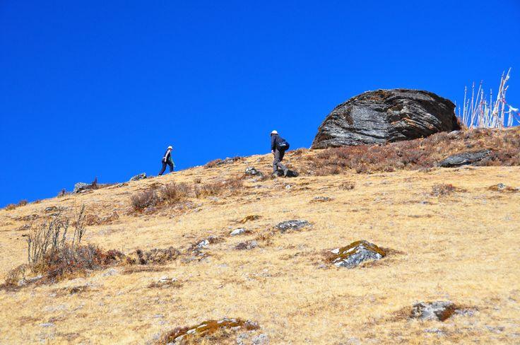 Seven Skies' founder Nathan Wedding and director Clare Turner trekking near Cheli La in Bhutan.