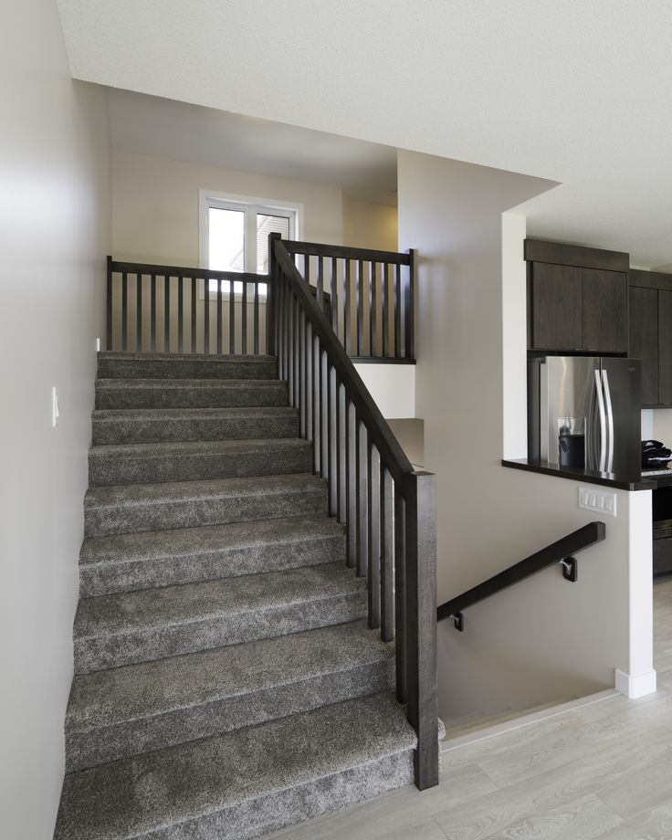 Staircase with beautiful dark wood railing
